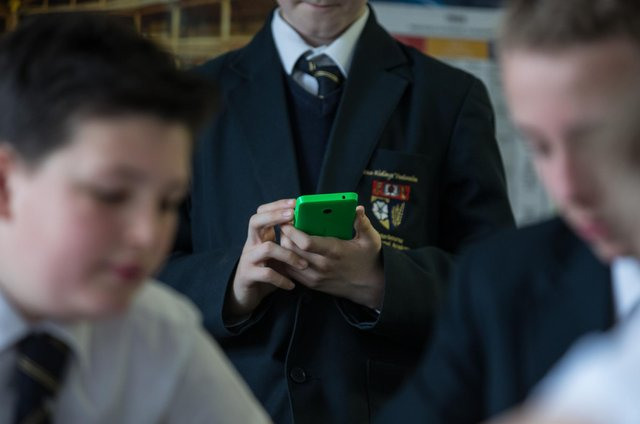 Should the government ban phones in schools?