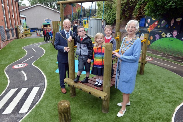 Henry Bradley Infant School's new playground area has been officially opened by the Mayor of Chesterfield Coun Glenys Falconer and consort Keith Falconer.