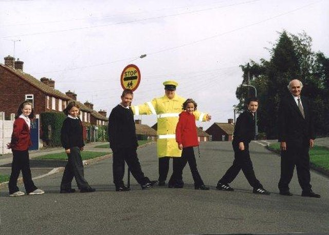 Brimington Junior School pupils support  International Walk To School Day in 2011. Kelsey Stirling, Eleanor Inman, Scott Cullen, Alice Brooks and Jason Mason are pictured with lollipop lady Trish Sinclair and Coun Walter Burrows.