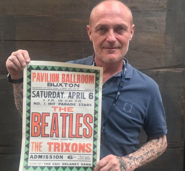 Karl Martin, valuer at Hansons, with The Beatles poster advertising their gig in Buxton.