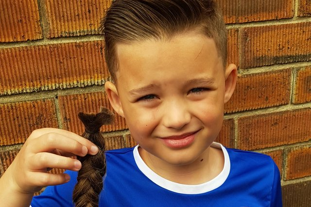 Todd Findlay, 7, has raised nearly £900 for the Steven Miller Foundation by chopping his hair off.