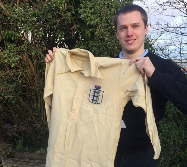 Sports valuer David Wilson-Turner with the England shirt from 1911 that sold for £4,000.
