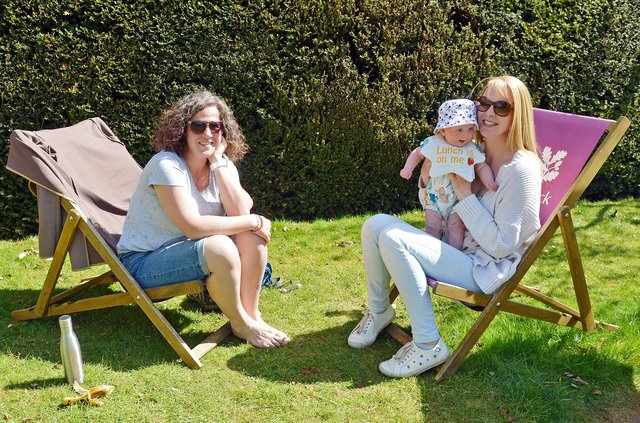 Hardwick Hall in spring bloom. Lorna Martin and Sophie and Harriet Hardstaff enjoying the spring sun in the South Lawn.