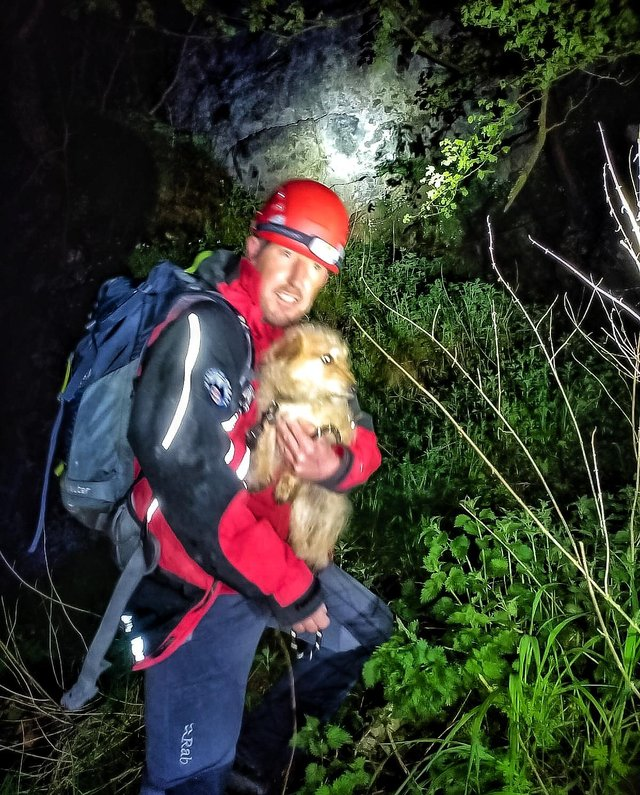 A Buxton Mountain Rescue Team member with the rescued dog.