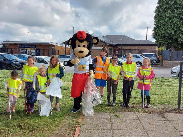 The children from Ladywood Primary School pictured with the Ben's Den mascot during their sponsored litter pick