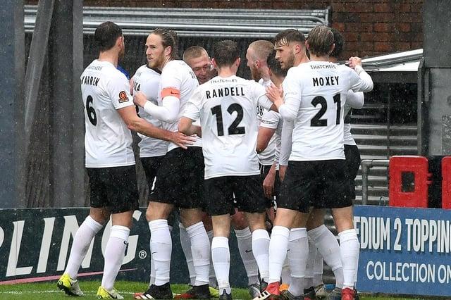 Torquay's players celebrate Connor Lemonheigh-Evans' goal.