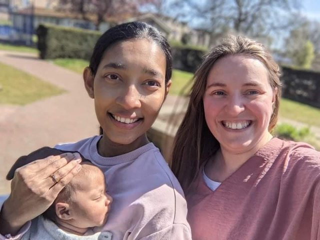Derbyshire doula Imogen Zybert pictured with a client and her baby