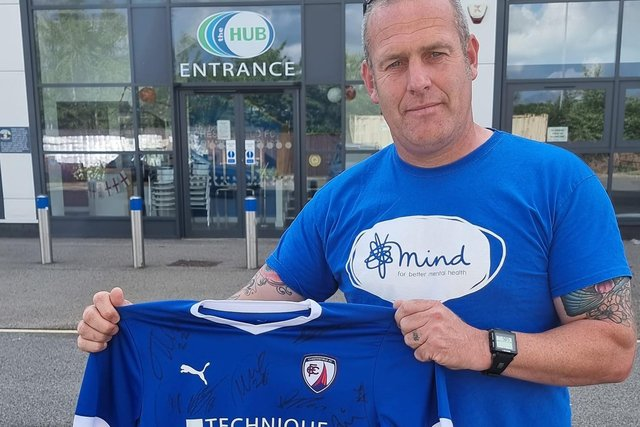 Adam Croser pictured with the signed Chesterfield FC shirt he hopes to give away to a young Spirite.