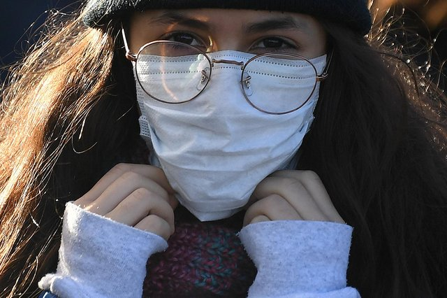 A woman wears a protective face mask as fears over coronavirus grow.. (Photo: Getty Images)