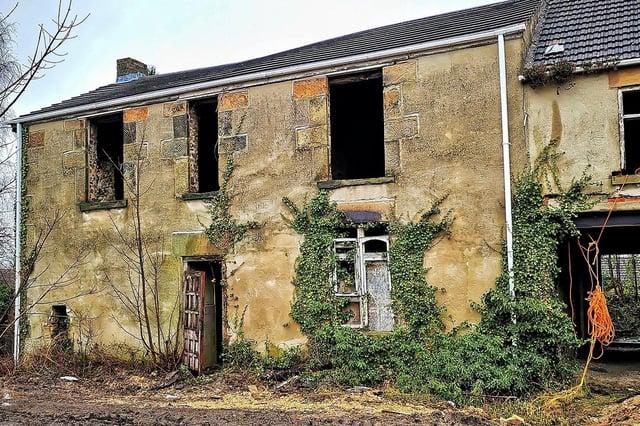 The abandoned Manor Syck Farm farmhouse.