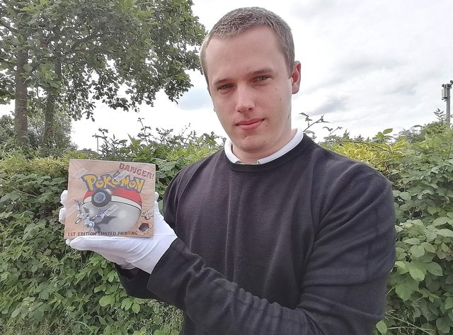 David Wilson-Turner with Pokemon Fossil Set First Edition which is estimated to raise £11,000 at auction.