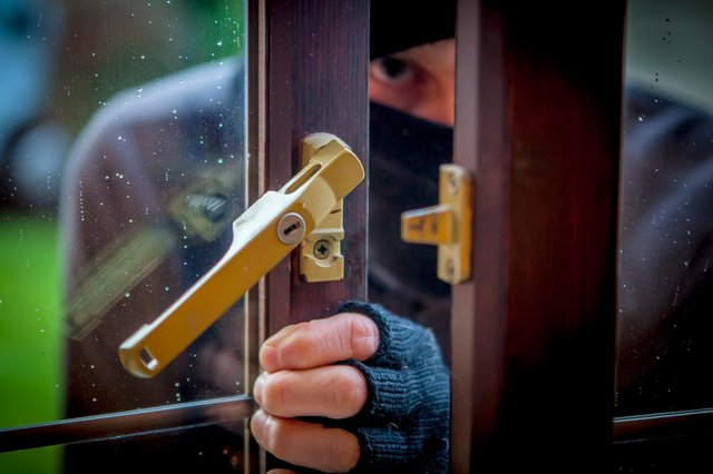 A thief stole bank cards and cash from an elderly Derbyshire man as part of a distraction burglary last week.