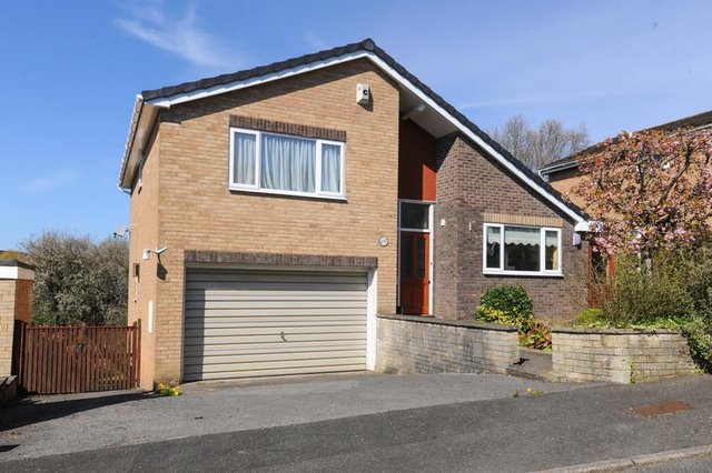 The property is a three-bedroom detached home.