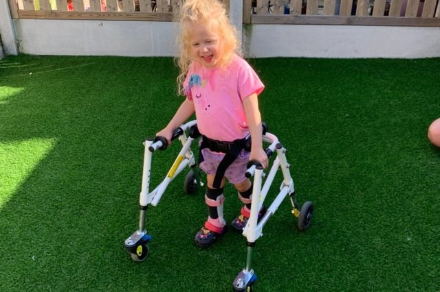 Darcie in her specialist walker.