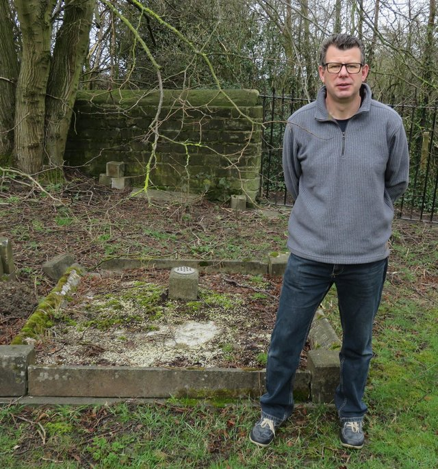 David Parmley at the grave of Phyllis Lee.