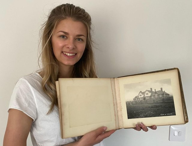 Alice Bennett with the album of photos taken when Bainbridge Hall in Bolsover was built to house the orphaned children of miners.