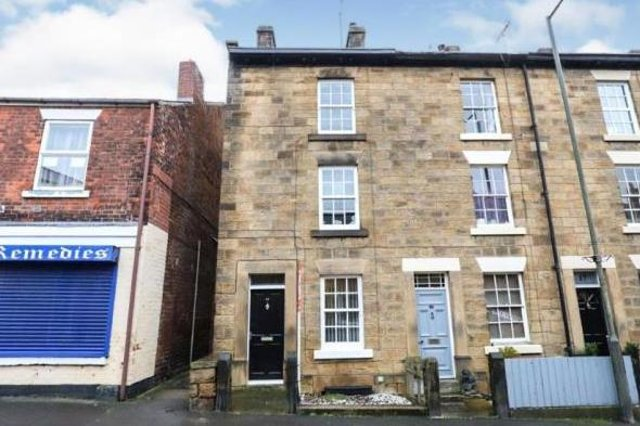 The property is at the end of four terraced town houses which together are Grade II-listed by Historic England.