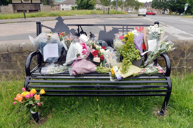 Flowers left for Gracie near the war memorial in Old Whittington