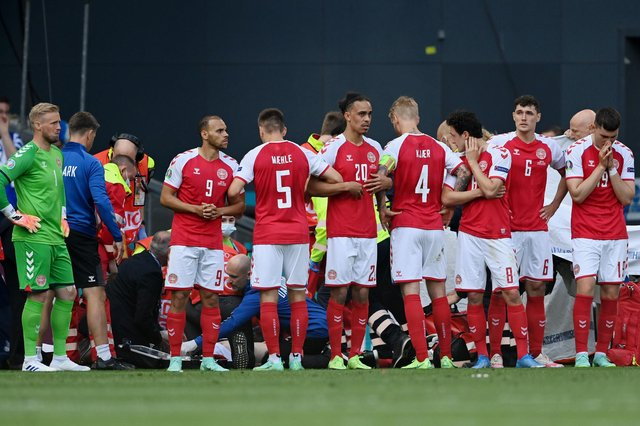 Denmark players surrounded teammate Christian Eriksen while he received CPR.