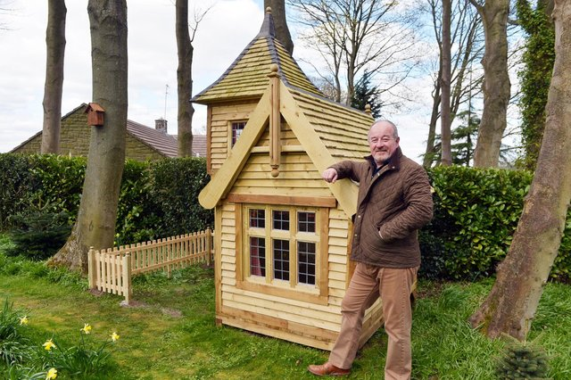 Mark Campbell with his amazing shed/treehouse/fantasy castle.
