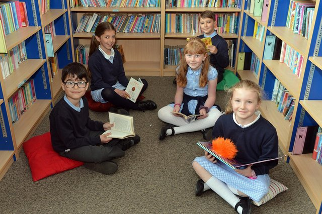 Year 3 children reading in the library at St Mary's School in Chesterfield, the most oversubscribed primary school in north Derbyshire for the 2021/22 academic year