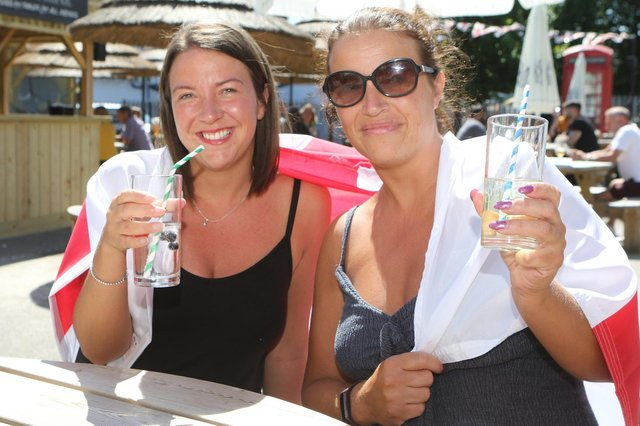 Laura and Mel Cliff enjoy the sunshine at the Spotted Frog, Brampton, Chesterfield.