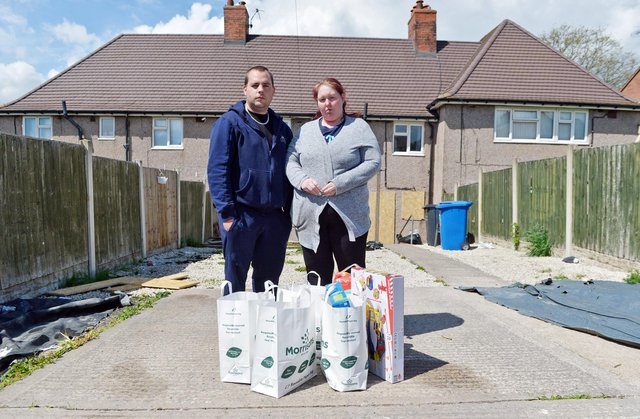 Amy and Latham Goucher with some of the donations they have received after the terrible blaze. Pictures by Brian Eyre.