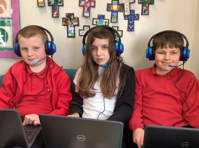 Year 6 pupils at Christ Church Primary making use of the new IT equipment which has been donated to the school by Asda