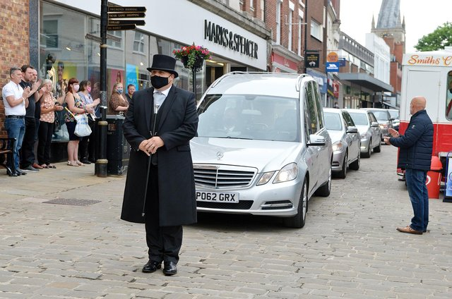 The funeral procession passes Don Hollingworth's old stall on Chesterfield Market.