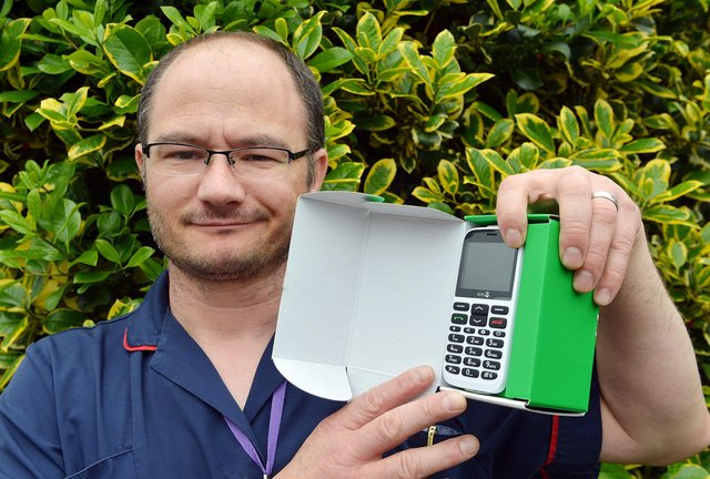With help from the DT, carer Neil Hawksworth has got a free mobile from Vodafone to give to one of his vulnerable clients who is in need of a new phone. Pictures by Brian Eyre.