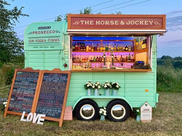 The mobile bar is housed in an old horse box.