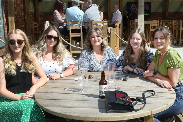 Drinkers enjoy the new beach-themed Spotted Frog beer garden.
