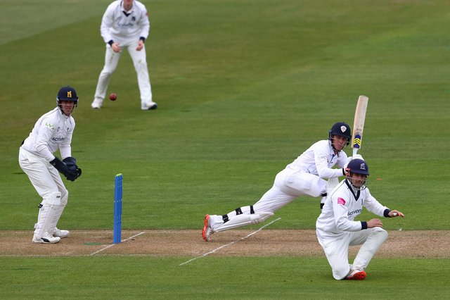Luis Reece of Derbyshire hits to the legside off the bowling of Danny Briggs of Warwickshire as Sam Hain takes cover at short leg during day one of the Group One LV Insurance County Championship match between Warwickshire and Derbyshire at Edgbaston on April 08, 2021 in Birmingham, England. (Photo by Michael Steele/Getty Images)