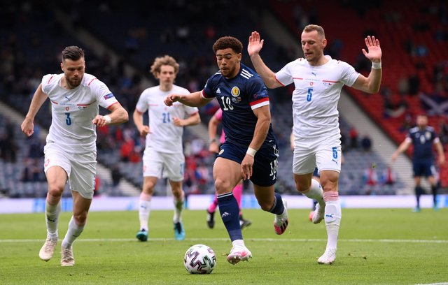 Che Adams runs with the ball whilst under pressure from Ondrej Celustka and Vladimir Coufal during the UEFA Euro 2020 Championship Group D match between Scotland and Czech Republic. (Photo by Stu Forster/Getty Images)