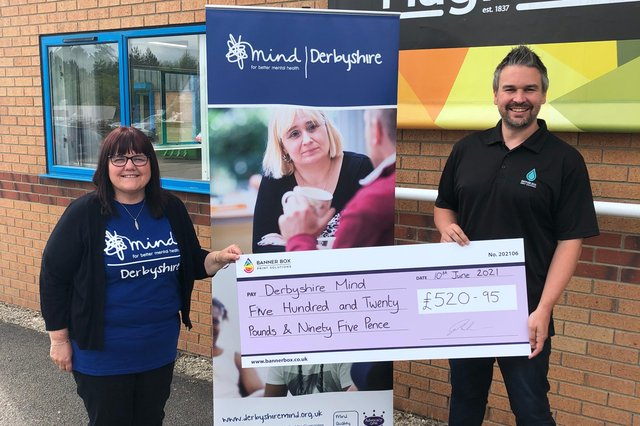 Debbie Locke from Derbyshire Mind accepts a cheque from Banner Box Print Solutions director Ryan Shelton.