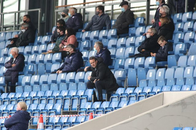 James Rowe had to sit in the stands after receiving a four-match touchline ban.
