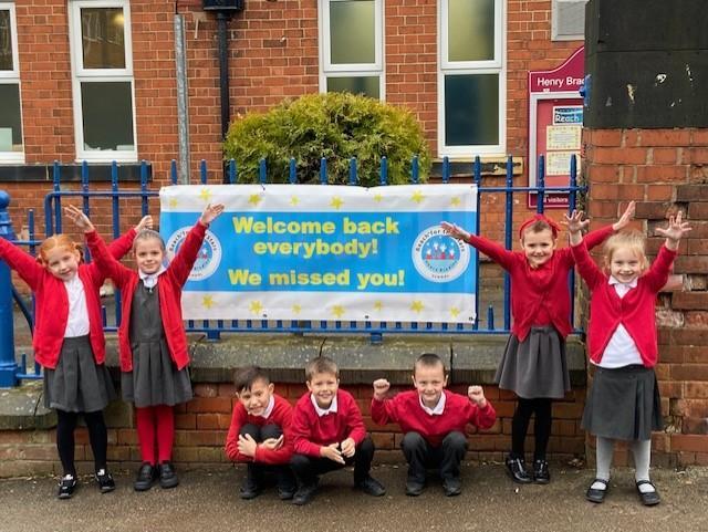 Children at Henry Bradley Nursery and Infant School celebrating on Monday