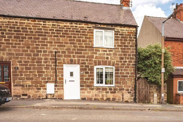 The property is a two-bedroom, semi-detached, stone-built cottage.