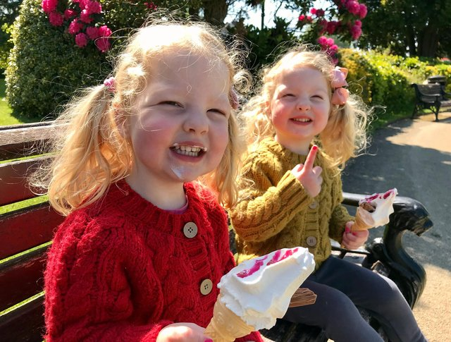 Enjoying the bank holiday sunshine are Lydia and Fearn with their ice creams.