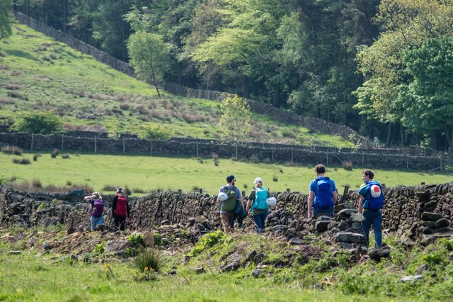 Walking in the Peak District is a popular hobby for visitors.