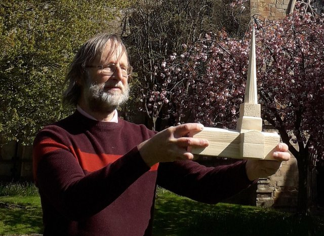 Martin Coslett, co-writer of The Crooked Spire murder-mystery musical, with a model of St Mary's Church, Chesterfield, as it would have looked when the spire was first built. Ashgate Heritage Arts believes it is the only model which depicts the church with a straight spire.