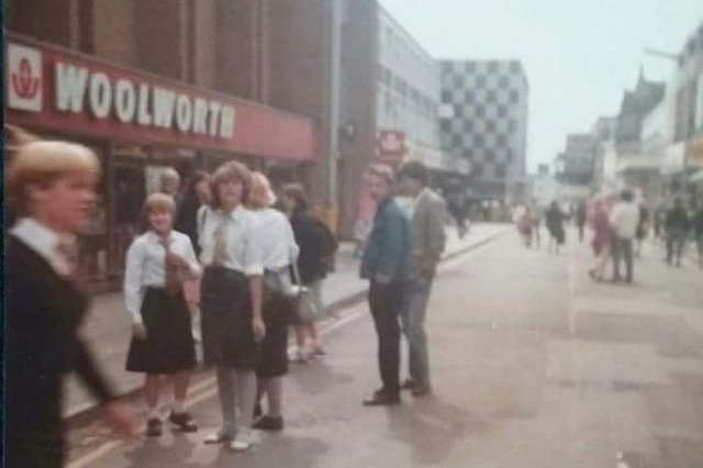 Outside the now-demolished Woolworths on Burlington Street in the early 1980s. Burlington House can be seen in background in the centre of the picture.