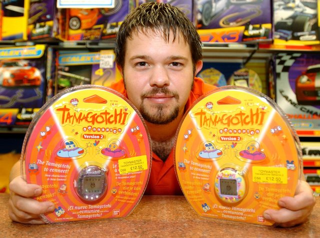 Tom Evans Assistant Manager of Toymaster in Meadowhall, with a Tamagotchi which was predicted  to  be a Christmas best seller
