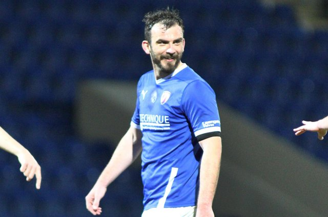 Gavin Gunning was forced off with a hamstring injury against Sutton United.