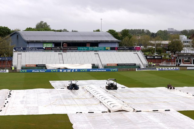 Covers are pictured over the crease due to poor weather prior to the LV= Insurance County Championship match between Derbyshire and Durham at The Incora County Ground on Friday. (Photo by Alex Pantling/Getty Images)