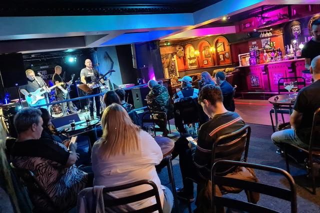 A socially-distanced show inside County Music Bar.