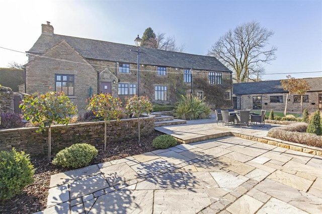The property dates back to the early 1500s and retains many original features including roof trusses and exposed stone work.