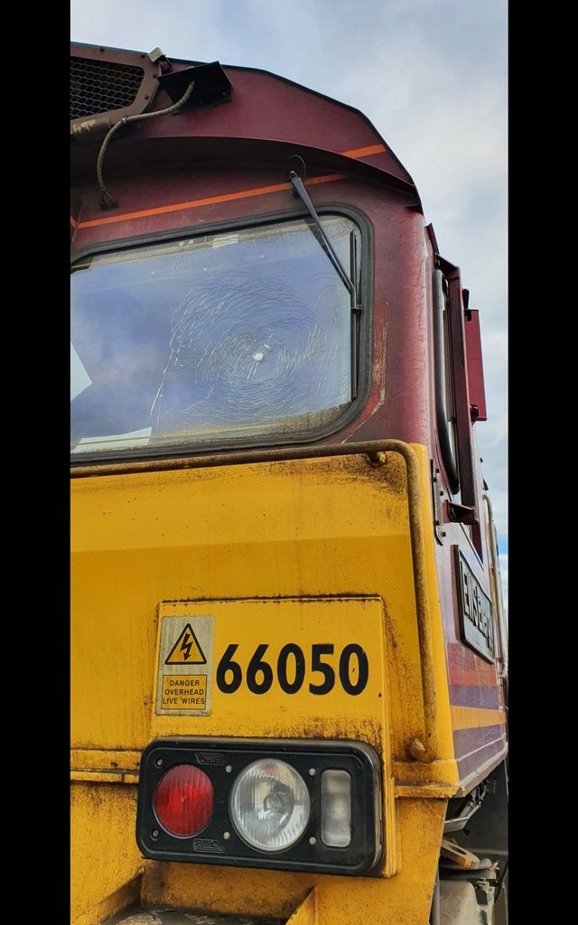 The object was thrown at the freight train and smashed its window