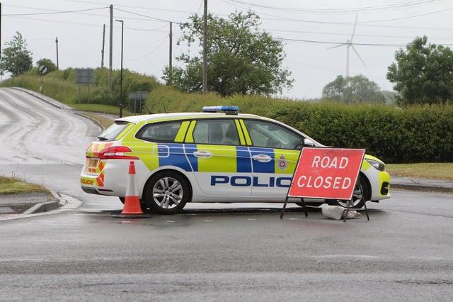 Police closed roads near Duckmanton.